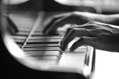 Piano keys with hand